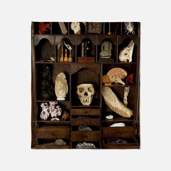 A cabinet of Curiosities Throw Blanket