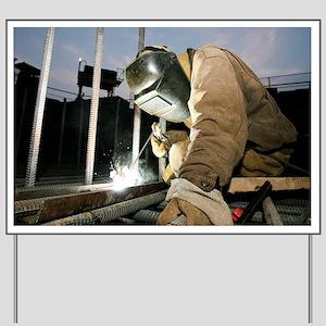 Welder working on a new bridge Yard Sign
