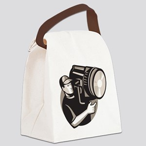 film crew with spotlight fresnel  Canvas Lunch Bag