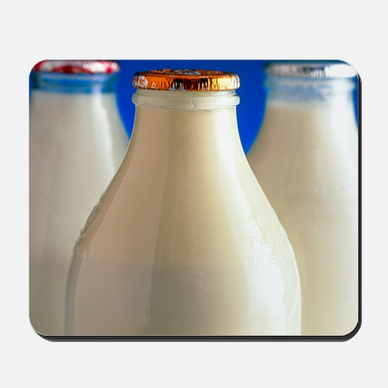 Tops of three types of bottled milk Mousepad