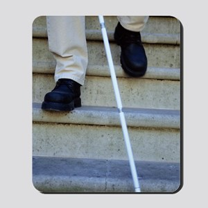 Blind man descending stairs Mousepad