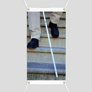 Blind man descending stairs Banner