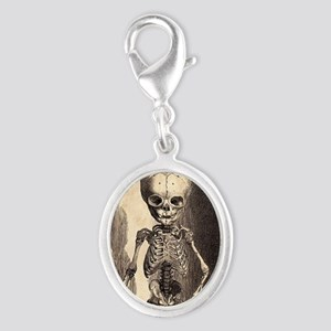 Skeletal Child Alcove Silver Oval Charm