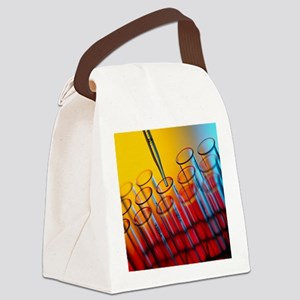 Pipette dipensing fluid into test Canvas Lunch Bag