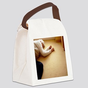 Elderly woman lying on the floor Canvas Lunch Bag