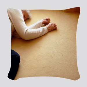 Elderly woman lying on the flo Woven Throw Pillow