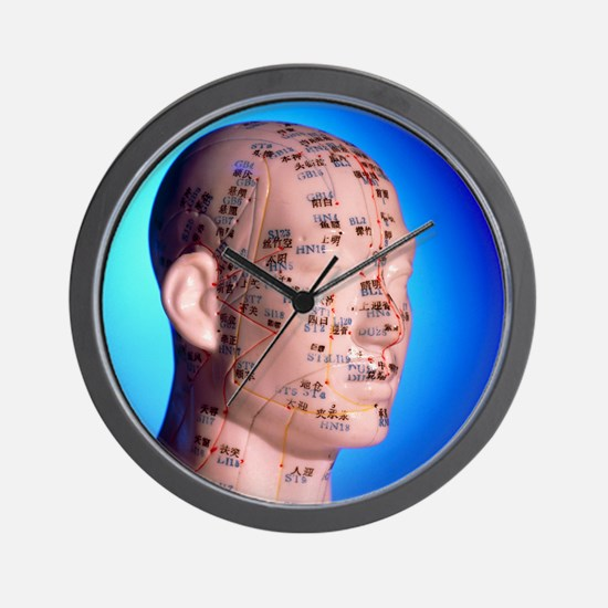 Acupuncture chart on a cast of a head a Wall Clock