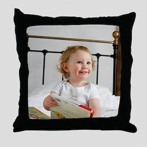 Baby boy reading Throw Pillow