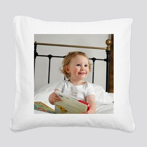 Baby boy reading Square Canvas Pillow
