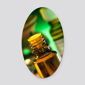 Bottles containing aromatherapy oi Oval Car Magnet