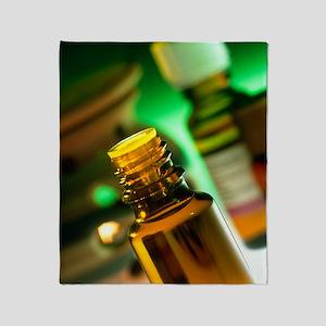 Bottles containing aromatherapy oil Throw Blanket