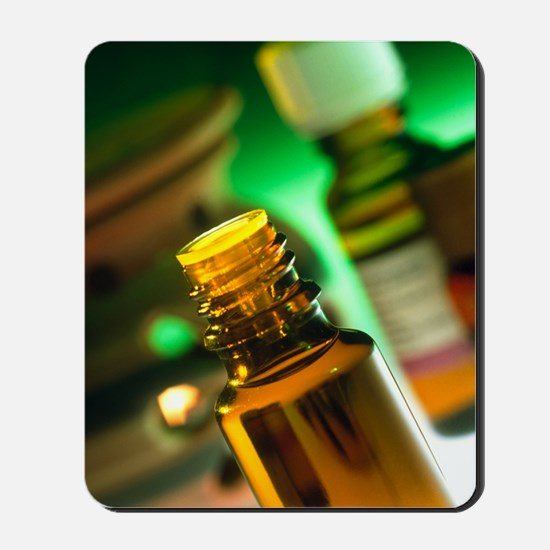 Bottles containing aromatherapy oil Mousepad