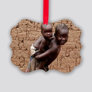 Child carrying a baby Picture Ornament