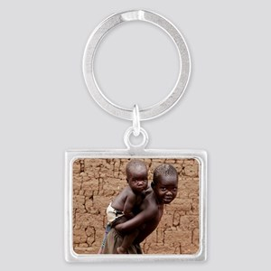 Child carrying a baby Landscape Keychain