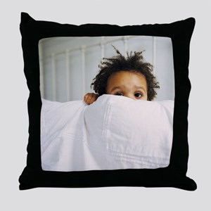 Boy playing Throw Pillow