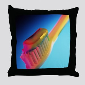 Close-up of toothpaste on a toothbrus Throw Pillow