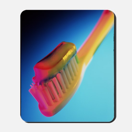Close-up of toothpaste on a toothbrush Mousepad