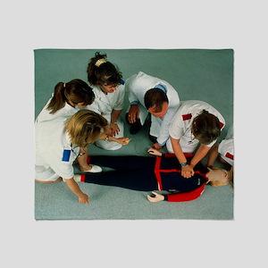 Cardiopulmonary resuscitation first  Throw Blanket