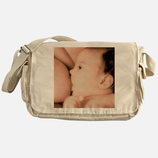 Close-up of a baby feeding at his mo Messenger Bag