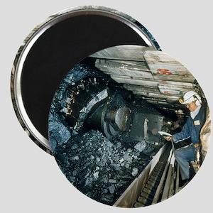 Technician measures noise levels in a coal  Magnet