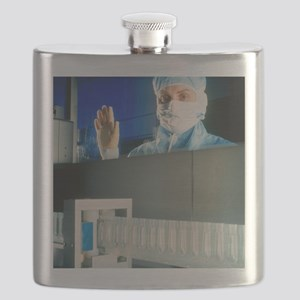 Technician monitoring suppository drug produ Flask