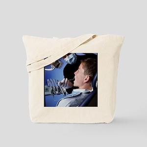 Dentist examining a boy's mouth Tote Bag