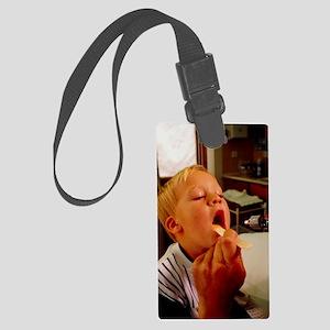 GP examining child's mouth Large Luggage Tag