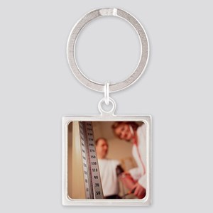 GP doctor taking blood pressure of Square Keychain