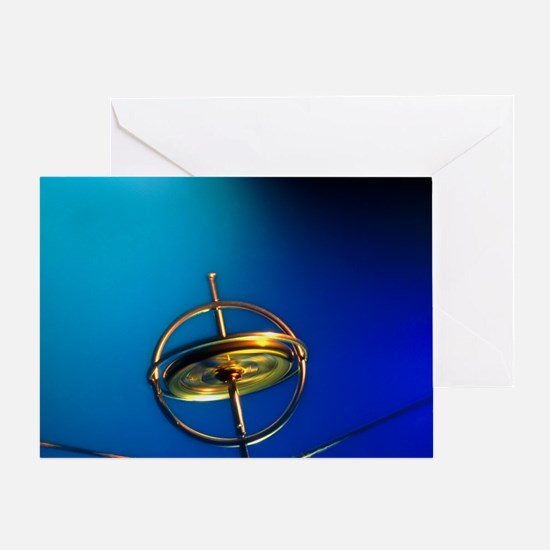 Gyroscope spinning on a piece of str Greeting Card