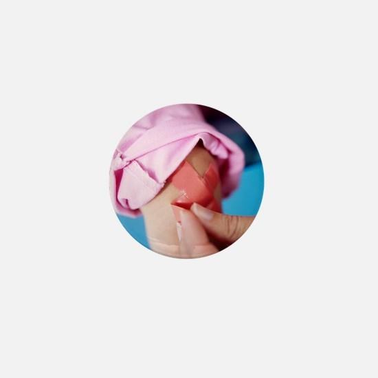 Injured baby girl Mini Button