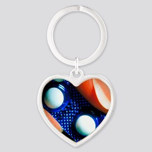 Morning after pills held in woman's Heart Keychain