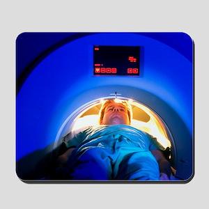 Patient passes into a CT scanner Mousepad
