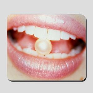 Pearl between teeth Mousepad