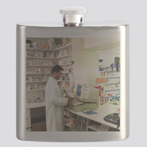 Pharmacist using a computer in a pharmacy Flask