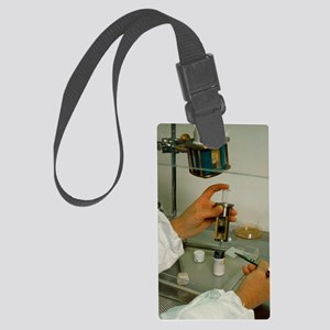 Preparing isotope injection for  Large Luggage Tag