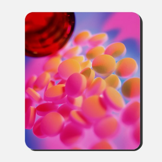 Scattered homeopathy pills next to a pil Mousepad