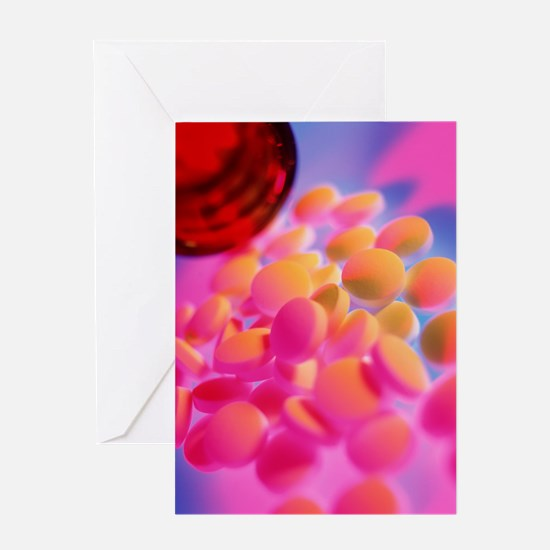 Scattered homeopathy pills next to a Greeting Card