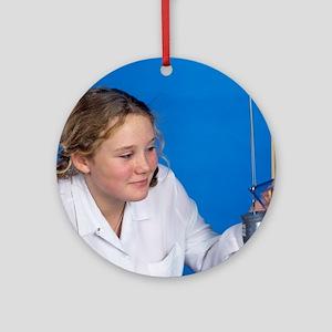 Schoolgirl investigating elasticity Round Ornament