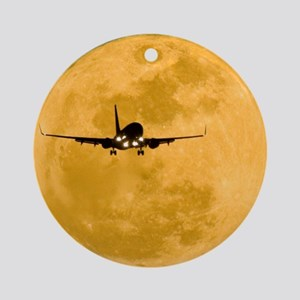 Aeroplane silhouetted against a ful Round Ornament