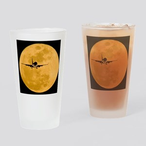 Aeroplane silhouetted against a ful Drinking Glass
