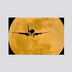 Aeroplane silhouetted against a f Rectangle Magnet