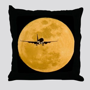 Aeroplane silhouetted against a full  Throw Pillow