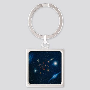 Artwork of various galaxies showin Square Keychain