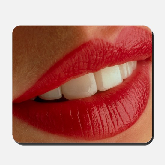 Close-up of a woman's mouth showing heal Mousepad