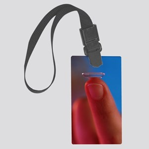 Contact lens seen on a fingertip Large Luggage Tag