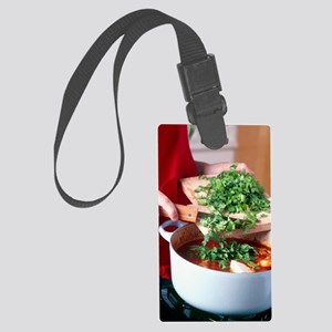 Cooking a casserole Large Luggage Tag