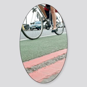 Cyclist in a cycle lane Sticker (Oval)