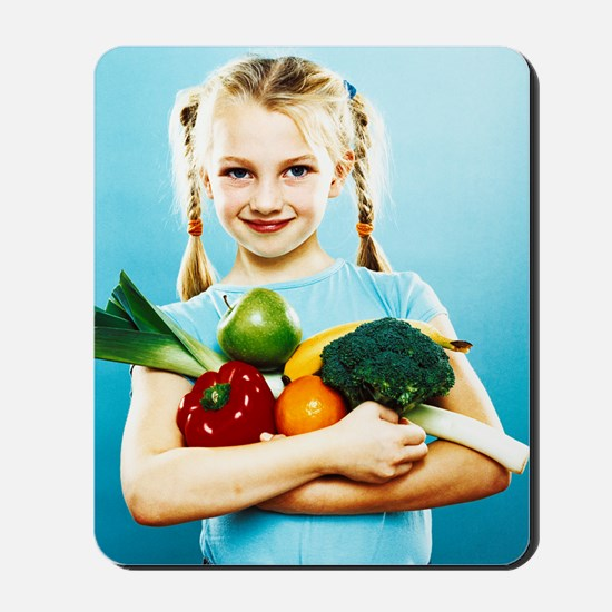 Girl holding fruit and vegetables Mousepad