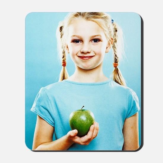 Girl holding an apple Mousepad