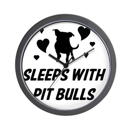 Sleeps with Pit Bulls Wall Clock